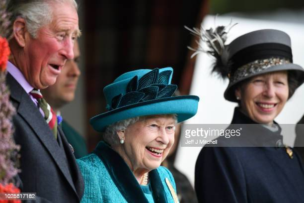 Queen Elizabeth II, Prince Charles, Prince of Wales and Princess Anne, Princess Royal attend the annual Braemar Highland Gathering on September 1,...