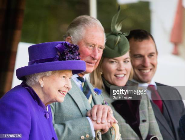 Queen Elizabeth II, Prince Charles, Prince of Wales, Autumn Phillips and Peter Phillips attend the 2019 Braemar Highland Games on September 07, 2019...