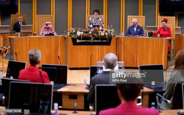 Queen Elizabeth II, Prince Charles, Prince of Wales, Camilla, Duchess of Cornwall listen as Llywydd Elin Jones gives her opening remarks inside the...