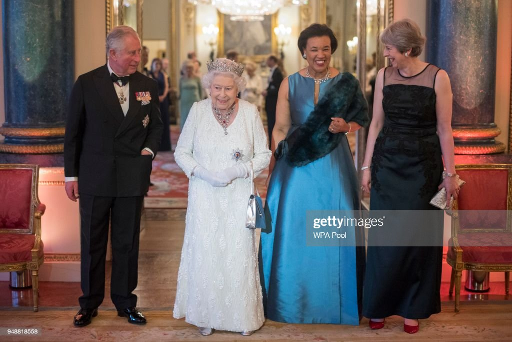 Queen Elizabeth II, Prince Charles, Prince of Wales, Commonwealth Secretary-General Patricia Scotland and Prime Minister Theresa May in the Blue Drawing Room at The Queen's Dinner during the Commonwealth Heads of Government Meeting (CHOGM) at Buckingham Palace on April 19, 2018 in London, England.