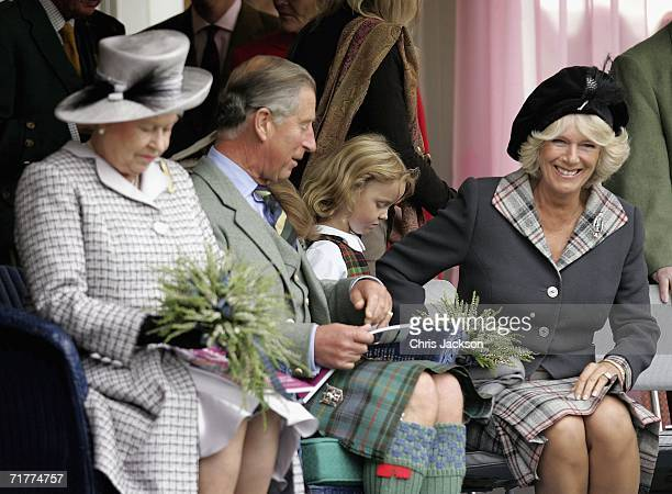 Queen Elizabeth II Prince Charles The Prince of Wales and Camilla Duchess of Cornwall attend the Braemar Gathering at the Princess Royal and Duke of...