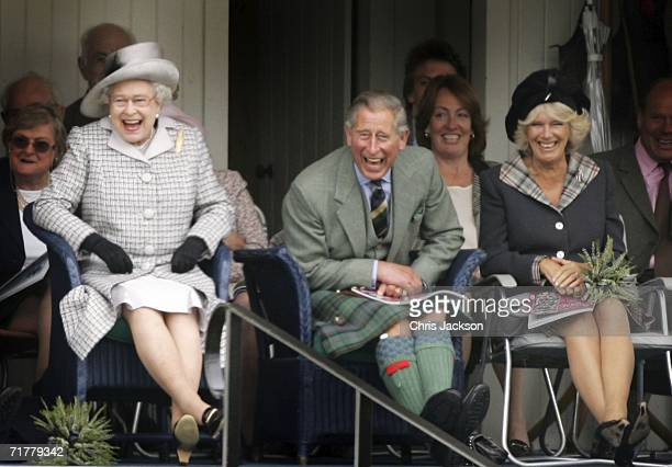 Queen Elizabeth II Prince Charles The Prince of Wales and Camilla Duchess of Cornwall watch competitors during the Braemar Gathering at the Princess...