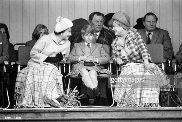 Queen Elizabeth II Prince Edward and Queen Elizabeth the Queen Mother attend the Braemar Highland Games on September 011975 in Braemar Scotland