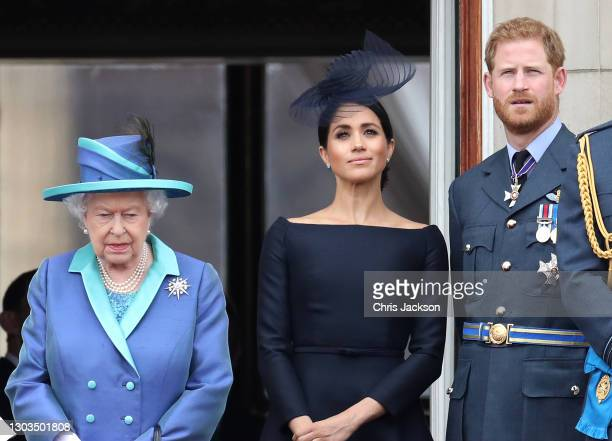 Queen Elizabeth II, Prince Harry, Duke of Sussex and Meghan, Duchess of Sussex on the balcony of Buckingham Palace as the Royal family attend events...