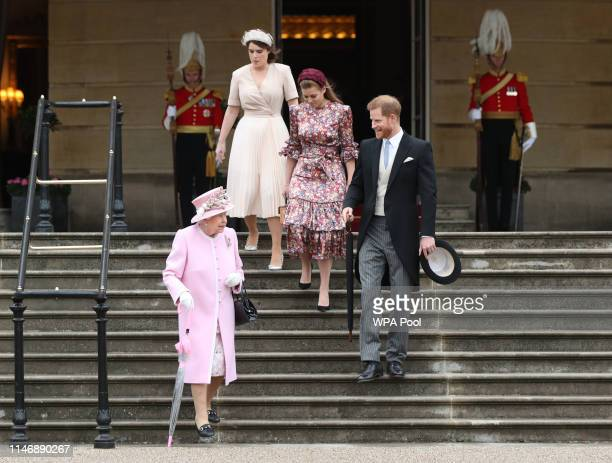 Queen Elizabeth II Prince Harry Duke of Sussex Princess Eugenie and Princess Beatrice attend the Royal Garden Party at Buckingham Palace on May 29...