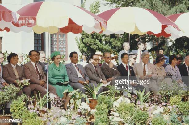 Queen Elizabeth II Prince Philip and British Foreign Secretary Geoffrey Howe in Kunming during their tour of China October 1986