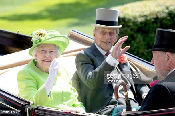 Queen Elizabeth II, Prince Philip, Duke of Edinburgh and Lord Vestey are seen during the Royal Procession on day 1 of Royal Ascot at Ascot Racecourse...