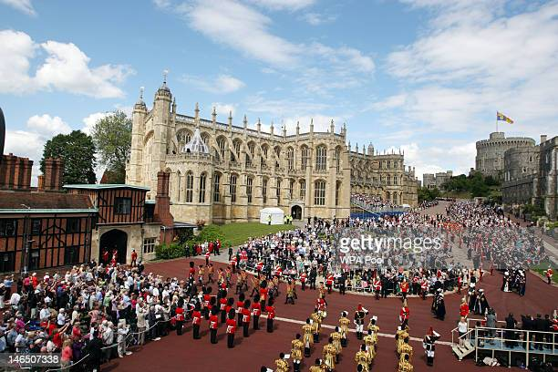 Queen Elizabeth II Prince Philip Duke of Edinburgh and other members of the Royal Family walk from Windsor Castle to King George VI chapel for the...