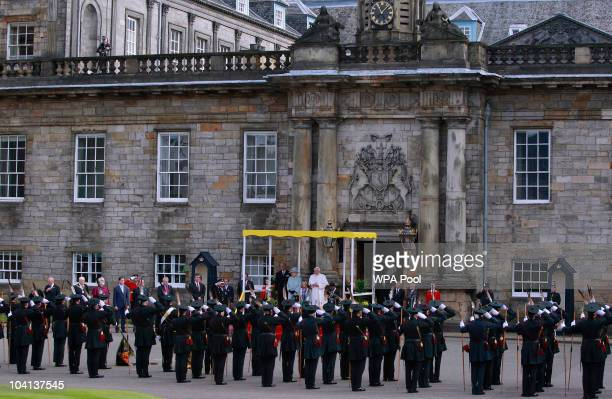 Queen Elizabeth II Prince Philip Duke of Edinburgh and Pope Benedict XVI inspect an honor guard of members of the Royal Company of Archers and...