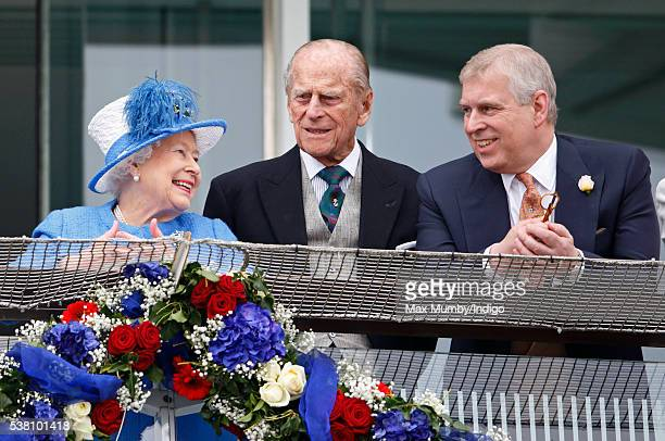 Queen Elizabeth II Prince Philip Duke of Edinburgh and Prince Andrew Duke of York watch the racing from the balcony of the Royal Box as they attend...