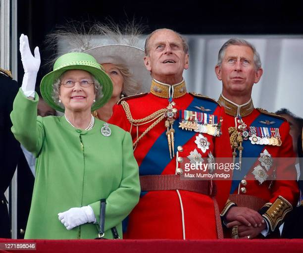 Queen Elizabeth II Prince Philip Duke of Edinburgh and Prince Charles Prince of Wales watch a flypast from the balcony of Buckingham Palace during...