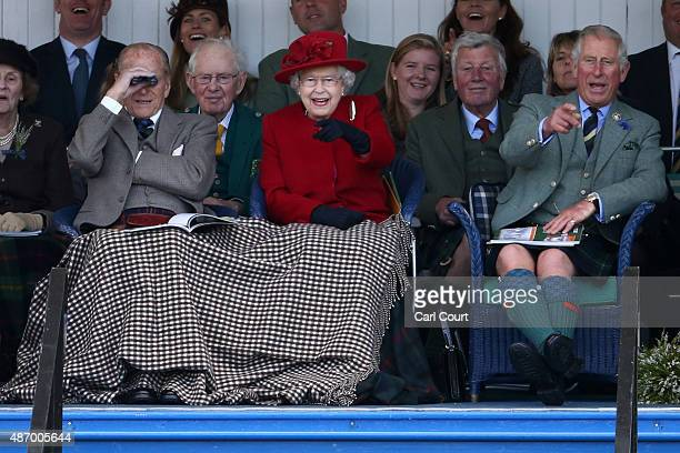 Queen Elizabeth II Prince Philip Duke of Edinburgh and Prince Charles Prince of Wales watch competitors at the Braemar Gathering on September 5 2015...