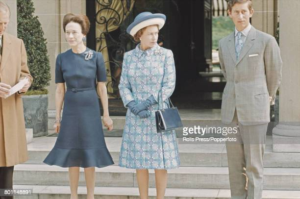Queen Elizabeth II Prince Philip Duke of Edinburgh and Prince Charles stand together with Wallis Simpson Duchess of Windsor during a visit by the...
