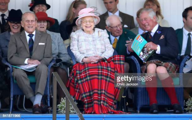 Queen Elizabeth II Prince Philip Duke of Edinburgh and Prince Charles Prince of Wales watch the 2017 Braemar Gathering at The Princess Royal and Duke...