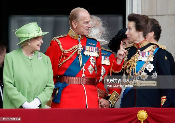 Queen Elizabeth II Prince Philip Duke of Edinburgh and Princess Anne Princess Royal watch a flypast from the balcony of Buckingham Palace during the...