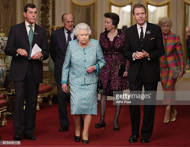 Queen Elizabeth II Prince Philip Duke of Edinburgh and Princess Anne attend a reception to showcase forestry projects that have been dedicated to the...
