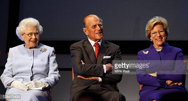 Queen Elizabeth II Prince Philip Duke of Edinburgh and Queen AnneMarie of Greece listen to a speech by King Constantine of Greece during the opening...