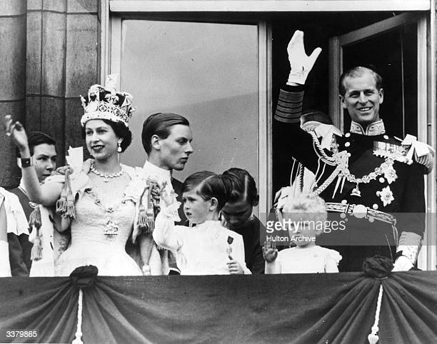 Queen Elizabeth II Prince Philip Duke of Edinburgh and their children Prince Charles and Princess Anne wave from the balcony at Buckingham Palace...