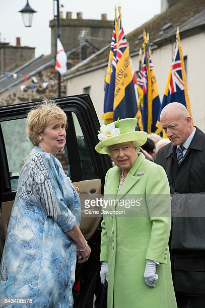 Queen Elizabeth II Prince Philip Duke Of Edinburgh attend the unveiling of the Robert Quigg VC memorial statue in Bushmills village on June 28 2016...