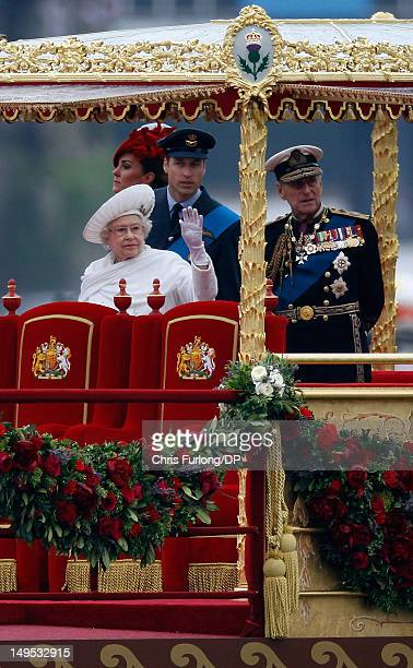 Queen Elizabeth II, Prince Philip, Duke of Edinburgh, Catherine, Duchess of Cambridge and Prince William, Duke of Cambridge sail on the royal barge...