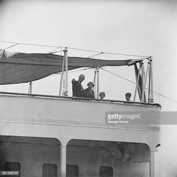 Queen Elizabeth II, Prince Philip, Duke of Edinburgh, Charles, Prince of Wales, and Anne, Princess Royal on Her Majesty's Yacht Britannia at the Port...