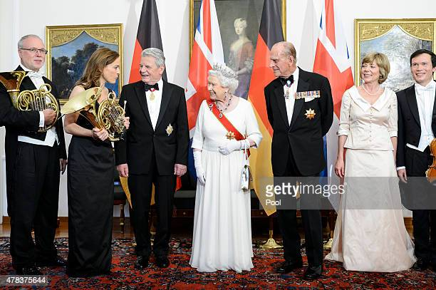 Queen Elizabeth II Prince Philip Duke of Edinburgh German President Joachim Gauck and Daniela Schadt meet the band ahead of a State Banquet on day 2...