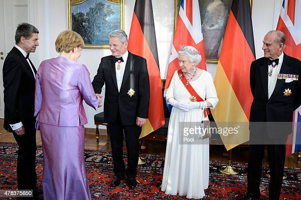 Queen Elizabeth II Prince Philip Duke of Edinburgh German President Joachim Gauck Joachim Sauer Chancellor Angela Merkel and Daniela Schadt attend a...