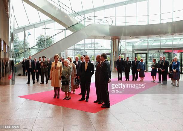 Queen Elizabeth II, Prince Philip, Duke of Edinburgh, Irish President Mary McAleese and her husband Martin McAleese listen to live classical music as...