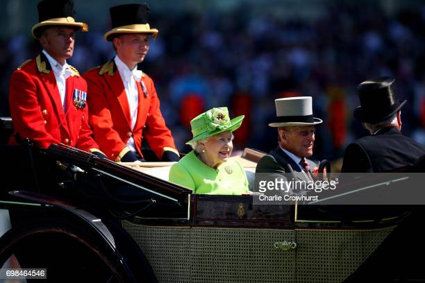 Queen Elizabeth II Prince Philip Duke of Edinburgh make their way in the royal procession during day 1 of Royal Ascot at Ascot Racecourse on June 20...