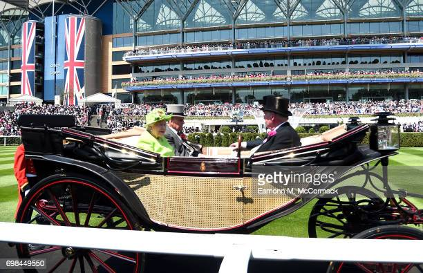 Queen Elizabeth II, Prince Philip, Duke of Edinburgh, Prince Andrew, Duke of York and Lord Vestey are seen during the Royal Procession on day 1 of...