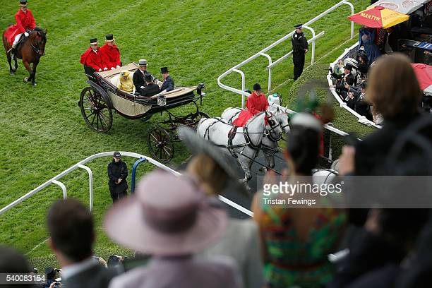 Queen Elizabeth II Prince Philip Duke of Edinburgh Prince Harry and Prince Andrew Duke of York arrive by carriage as seen from the Royal Enclosure...