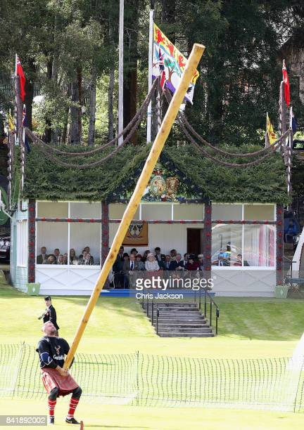 Queen Elizabeth II Prince Philip Duke of Edinburgh Princess Anne Princess Royal and Prince Charles Prince of Wales watch the caber toss from the...