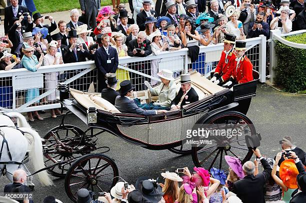 Queen Elizabeth II, Prince Philip, Duke of Edinburgh, The Emir of Qatar and The Lord Vestey during the Royal Procession on day two of Royal Ascot at...