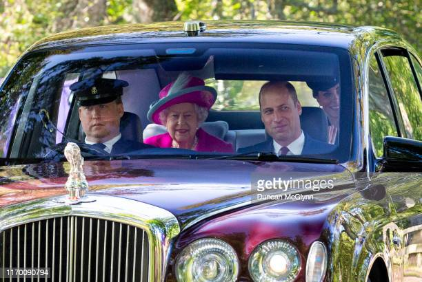 Queen Elizabeth II, Prince William, Duke of Cambridge and Catherine, Duchess of Cambridge drive to Crathie Kirk Church before the service on August...