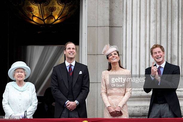 Queen Elizabeth II Prince William Duke of Cambridge Prince Harry and Catherine Duchess of Cambridge on the balcony of Buckingham Palace after the...