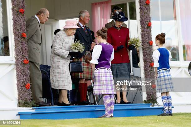 Queen Elizabeth II Princess Anne Princess Royal and Prince Charles Prince of Wales watch the 2017 Braemar Gathering at The Princess Royal and Duke of...