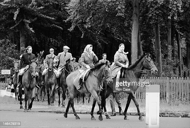 Queen Elizabeth II Princess Margaret and Antony ArmstrongJones with a group of others on their way to the race course at Ascot 20th June 1969