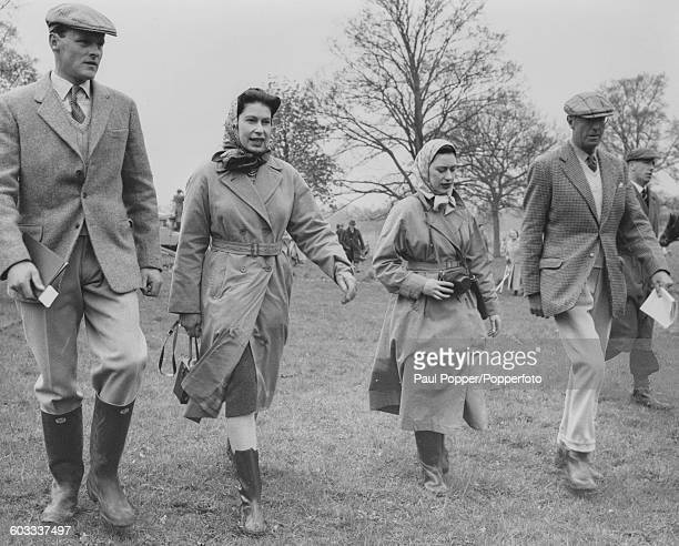 Queen Elizabeth II Princess Margaret and Henry Somerset 10th Duke of Beaufort walk together to one of the jumps at the Badminton Horse Trials in...