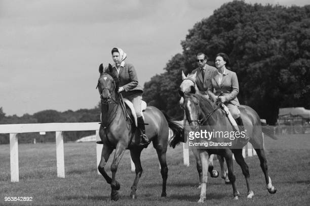 Queen Elizabeth II, Princess Margaret, Countess of Snowdon , and Prince Edward, Duke of Kent, riding at Ascot Racecourse, UK, 27th June 1968.