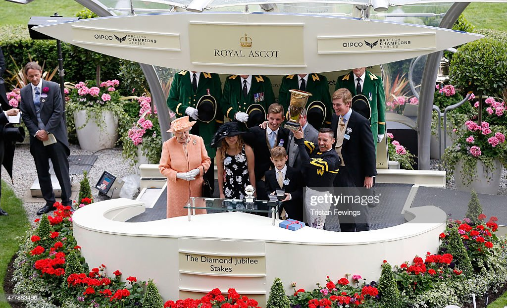 Queen Elizabeth II prsents the Diamond Jubilee Stakes with winning jockey Frankie Dettori and trainer of Undrafted Wesley A. Ward during day 5 of Royal Ascot 2015 at Ascot racecourse on June 20, 2015 in Ascot, England.