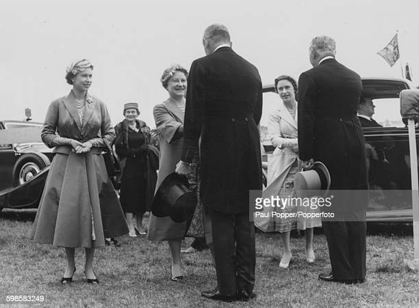 Queen Elizabeth II , Queen Elizabeth the Queen Mother and Princess Margaret are greeted by stewards as they arrive at Epsom Racecourse for the Derby,...