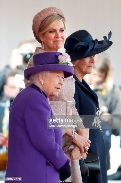 Queen Elizabeth II, Queen Maxima of the Netherlands and Camilla, Duchess of Cornwall attend a ceremonial welcome at Horse Guards Parade as Queen...