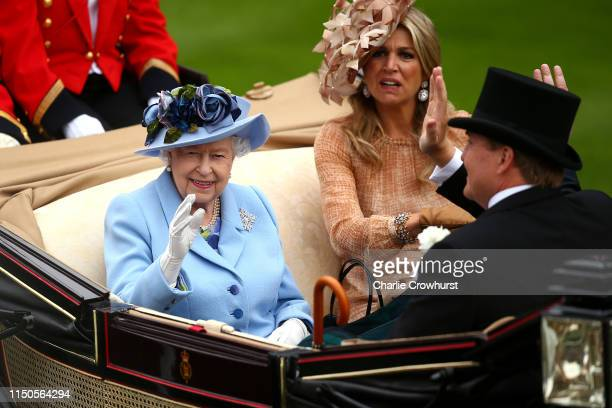 Queen Elizabeth II, Queen Máxima of the Netherlands and King Willem-Alexander of the Netherlands wave to the crowds as she arrives on day one of...