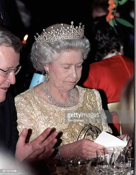 Queen Elizabeth II Reading The Menu At The Banquet At The Natural History Museum In London Hosted By The Queen Of Denmark