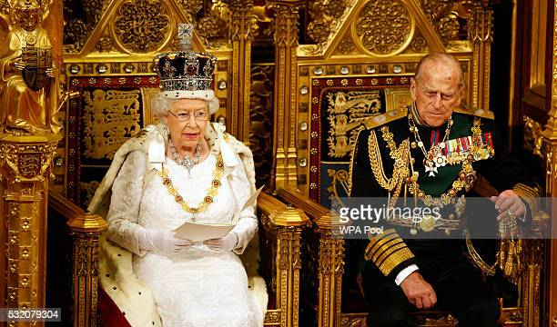 Queen Elizabeth II reads the Queen's Speech on her throne as Prince Philip Duke of Edinburgh listens during State Opening of Parliament in the House...