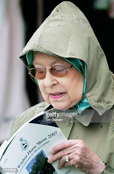 Queen Elizabeth II reads the Royal Windsor Horse Show programme of events on the second day of the show on May 11, 2007 in Berkshire, England.
