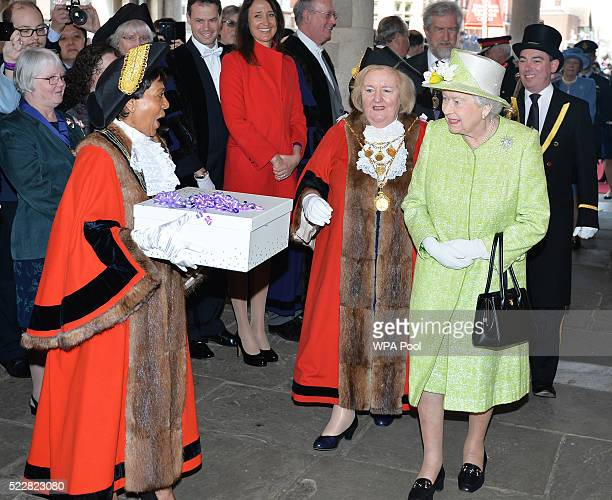 Queen Elizabeth II receives a gift during her 90th Birthday Walkabout on April 21 2016 in Windsor England Today is Queen Elizabeth II's 90th Birthday...