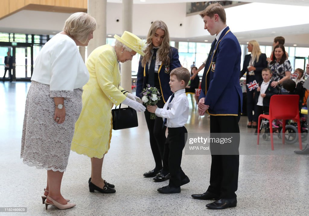 The Queen Visits Greenfaulds High School In Glasgow : News Photo