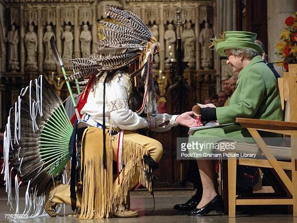 Queen Elizabeth II receives a scroll from Bruce Two Dogs Bozsum at Southwark Cathedral where she attended a funeral blessing to the Mohegan chieftain...