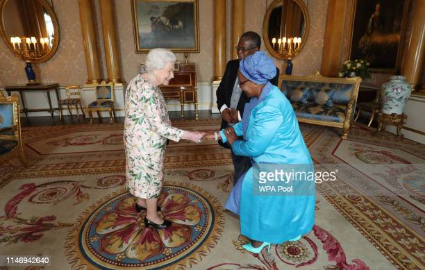 Queen Elizabeth II receives Dr John Gosiamemang Ndebele Seakgosing High Commissioner for the Republic of Botswana and his wife Lulu Talita Seakgosing...